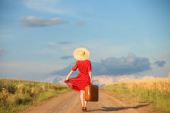 Redhead girl. With suitcase at outdoor Royalty Free Stock Photo