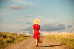 Redhead girl. With suitcase at outdoor Royalty Free Stock Image