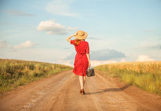 Redhead girl. With suitcase at outdoor Stock Photography