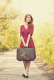 Redhead girl with suitcase Royalty Free Stock Photography