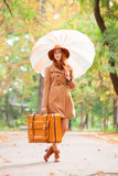Redhead girl with suitcase Stock Photo
