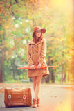Redhead girl with suitcase Royalty Free Stock Image