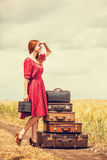 Redhead girl with suitcases. At outdoor Stock Image