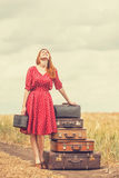 Redhead girl. With suitcases at outdoor Stock Photos