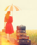 Redhead girl with suitcases Stock Image