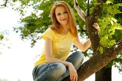 Redhead girl at summer park. Royalty Free Stock Photos