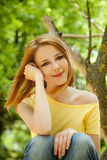 Redhead girl at summer park. Stock Photo