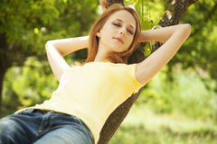 Redhead girl at summer park. Stock Image