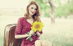 Redhead girl with sunflower at outdoor. Stock Photos