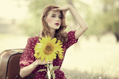 Redhead girl with sunflower at outdoor. Stock Photo