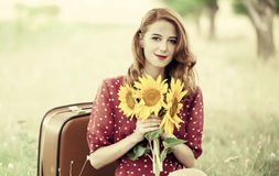 Redhead girl with sunflower at outdoor. Stock Image