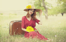 Redhead girl with sunflower at outdoor. Redhead girl with sunflower at outdoor Stock Image