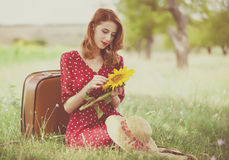Redhead girl with sunflower. At outdoor Stock Photo