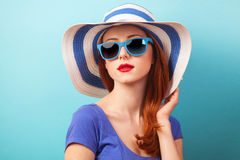 Redhead girl with sunglasses Stock Photography