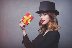 Redhead girl in top hat with gift box Royalty Free Stock Photography