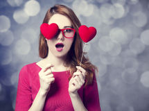 Redhead girl with two hearts. Royalty Free Stock Image