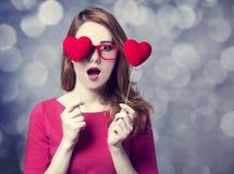 Redhead girl with two hearts. Beautiful redhead girl with two hearts Royalty Free Stock Image