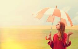 Redhead girl with umbrella Stock Photo