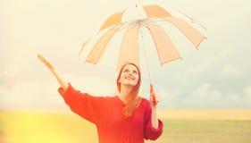 Redhead girl with umbrella Royalty Free Stock Photos