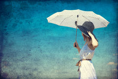 Redhead girl with umbrella at outdoor. Redhead girl with umbrella at outdoor Stock Image