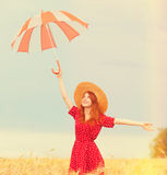 Redhead girl with umbrella Stock Images