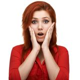 Redhead  girl unpleasantly surprised Stock Photos