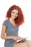 Redhead girl using a tablet pc Royalty Free Stock Images