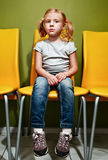 Redhead girl waiting in reception room. Stock Image