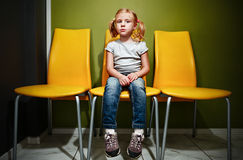 Redhead girl waiting in reception room. Stock Photo
