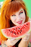 Redhead  girl with   watermelon Royalty Free Stock Photos