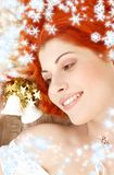 Redhead girl with white christ Royalty Free Stock Photos