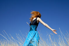 Redhead girl at windy field. Autumn Stock Photography