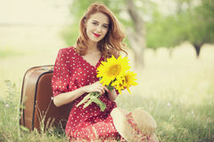 Redhead Girl With Sunflower At Outdoor. Royalty Free Stock Photos