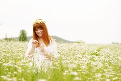 Redhead girl in daisy flower royalty free stock image