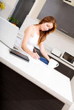 Redhead girl working in kitchen Royalty Free Stock Photo
