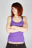 Redhead girlwith crossed hands, dissatisfaction Royalty Free Stock Images