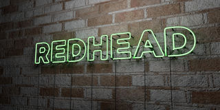 REDHEAD - Glowing Neon Sign on stonework wall - 3D rendered royalty free stock illustration Stock Photos