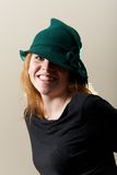 Redhead in green hat and black top Stock Images