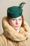 Redhead in green hat and fur coat Stock Photo