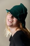 Redhead in green hat with head tilted Royalty Free Stock Image
