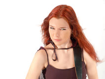 Redhead Guitarist 3. Beautiful Gothic redhead with intense expression Isolated over white royalty free stock image