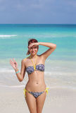 The redhead happy young woman standing at the ocean shore Royalty Free Stock Image