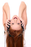 Redhead with headphones Royalty Free Stock Photos