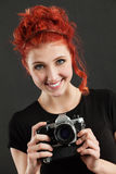 Redhead holding a camera Royalty Free Stock Images