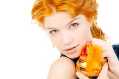 Redhead holding christmas toy Stock Photography