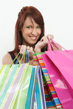 Redhead holding shopping bags Stock Image