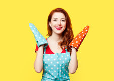 Redhead housewife with oven gloves Royalty Free Stock Image
