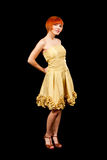 Redhead im gelben Kleid Stockbild