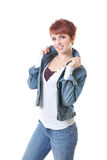 Redhead in jeans and jean jacket popping collar royalty free stock photo