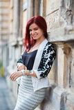 Redhead lady in urban environment Royalty Free Stock Photo